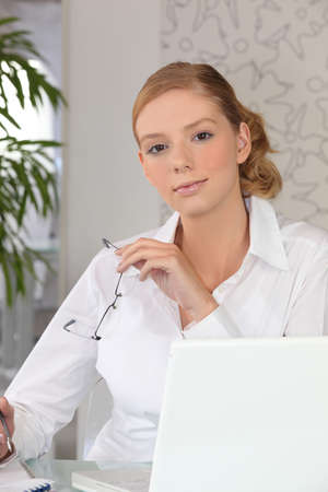 jot: A secretary in front of her laptop
