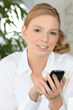 Young woman using a smartphone Stock Photo - 13897775
