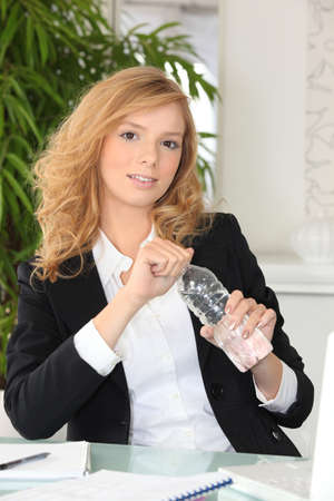 Red-haired woman with water bottle photo