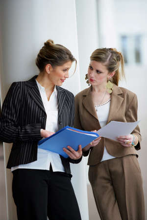 Businesswomen discussing documents photo