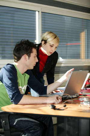Young people at an office computer Stock Photo - 13826631