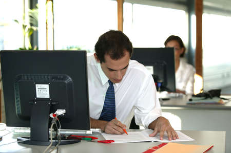 clerical: Office worker reviewing a file