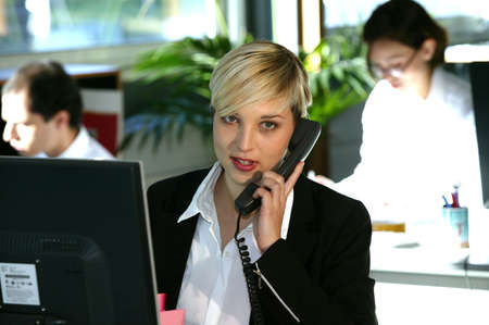 Busy blond office worker photo