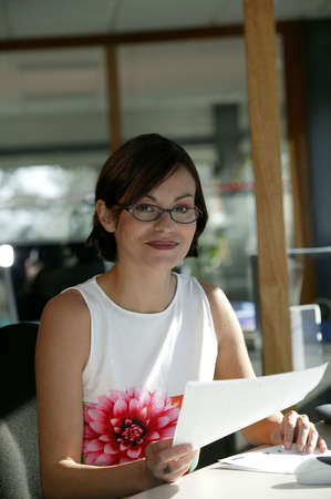 intelligently: Brunette administrative worker