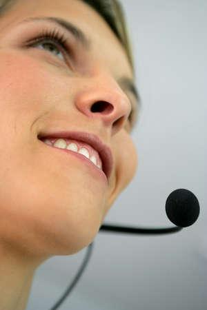 Close-up shot of a woman wearing a headset photo