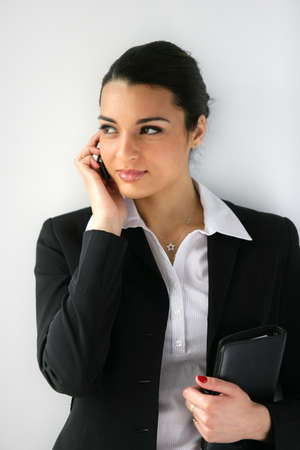 Businesswoman clutching diary Stock Photo - 13849260
