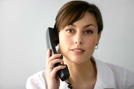Woman taking a phone call photo