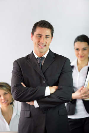 Boss stood with employees Stock Photo - 13850896