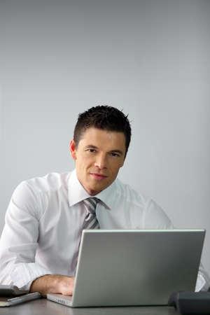 Young salesman sat at desk