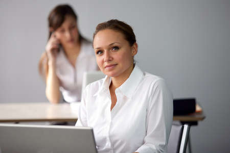 Pretty employee at her desk Stock Photo - 13851992