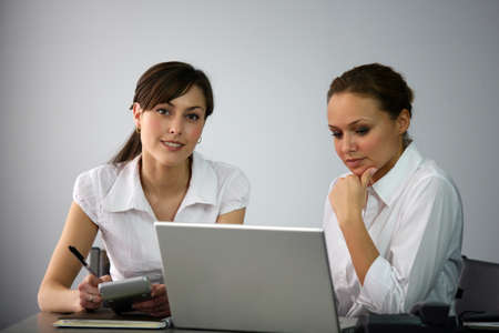 Clerical workers in front of a laptop photo