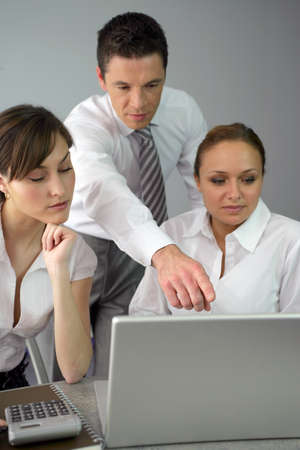 businesspeople working at the office photo