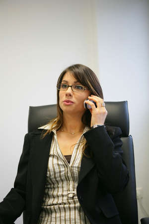 Businesswoman talking on the phone photo