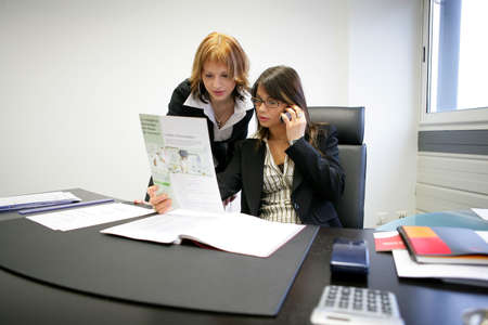 businesswoman and assistant working at the office photo