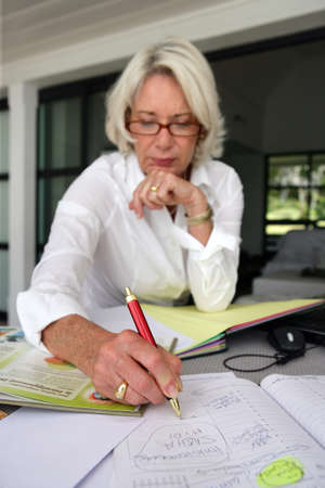 home planning: Mature woman writing