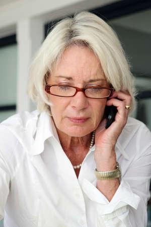 telephone call: Mature businesswoman making telephone call