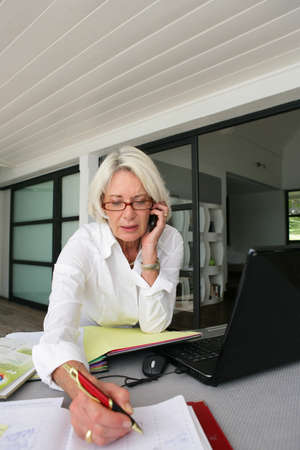 senior businesswoman working at home photo