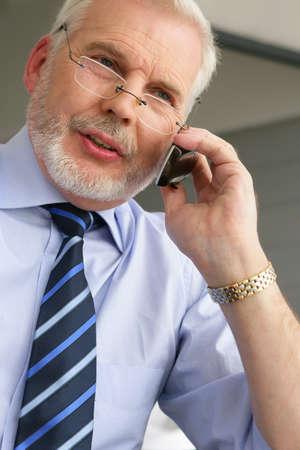 Empresario principal en el tel�fono Foto de archivo - 13884348