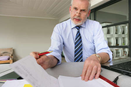 senior businessman working at his desk photo