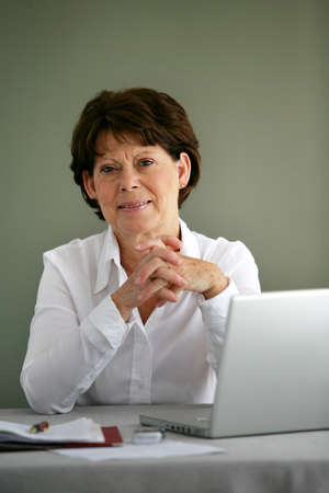 Portrait of a middle-aged woman with her laptop photo