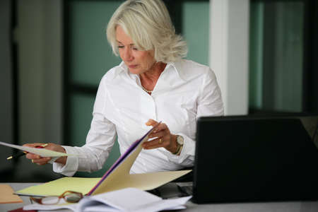 legal services: Woman looking through some files