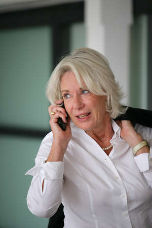 Senior businesswoman on the phone photo