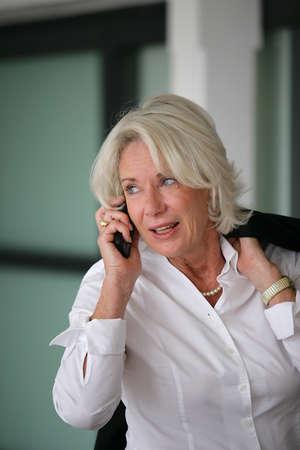 Senior businesswoman on the phone photo