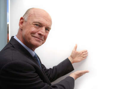 Bald businessman drawing attention to white-board Stock Photo - 13828739
