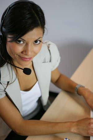 secretary desk: Woman wearing a headset