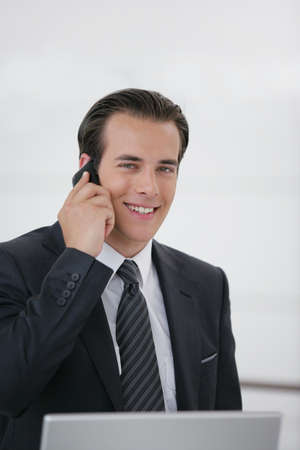 Businessman talking on his mobile phone photo