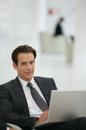 business lounge: Businessman waiting for his flight Stock Photo