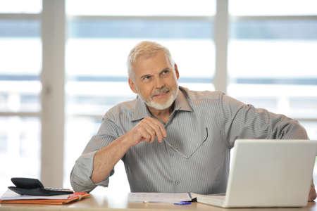Grey-haired company boss photo