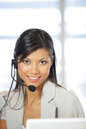 Portrait of a happy secretary wearing a headset Stock Photo - 13852479