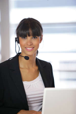 Businesswoman in a telephone headset Stock Photo - 13834482