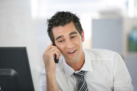 Businessman laughing on the phone Stock Photo - 13851340