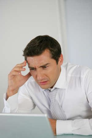 Businessman is getting stressed photo