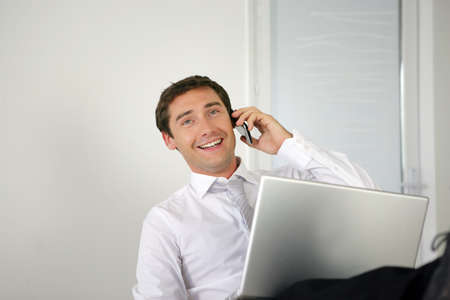 Businessman lauging on the phone Stock Photo - 13850862