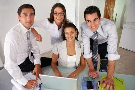 entrepreneurs: Business team posing together