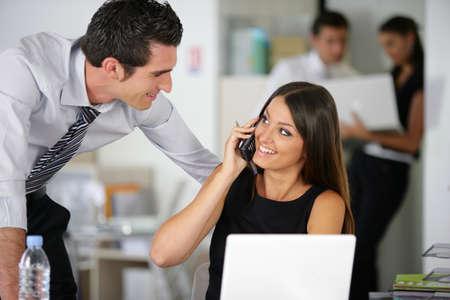flirting: Office life Stock Photo