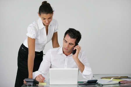 businessman and his assistant working at the office photo