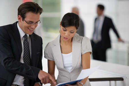 Businesspeople reviewing paperwork photo