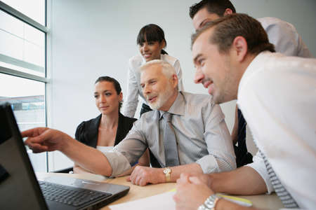 sales manager: Salesteam in front of computer Stock Photo
