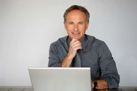 Businessman using a laptop computer photo