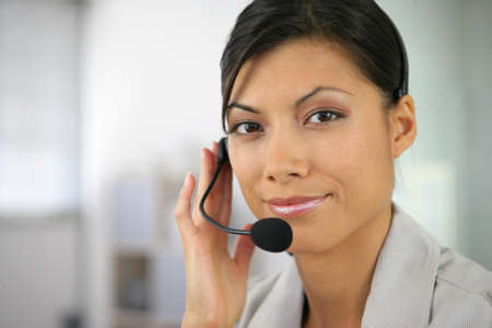 Woman wearing a headset Stock Photo - 13853557