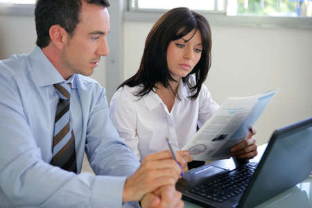 Businesspeople going over document photo