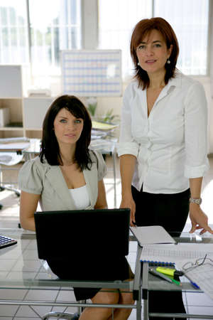 two businesswomen working at the office photo