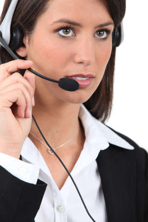Businesswoman with telephone head set photo