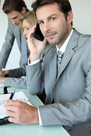 Executive on cellphone Stock Photo - 13912412