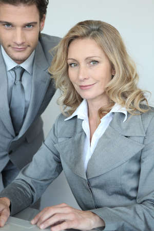 collaborators: businessman and businesswoman with laptop Stock Photo