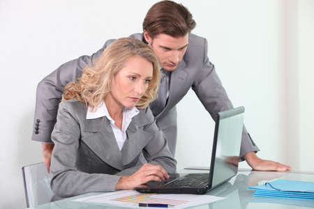 collaborators: Executives with laptop computer